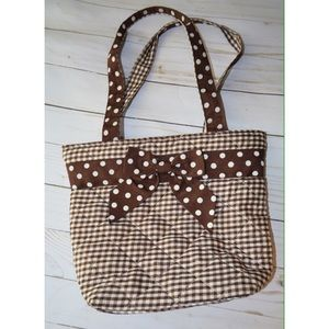 Gingham brown and white purse small in size.